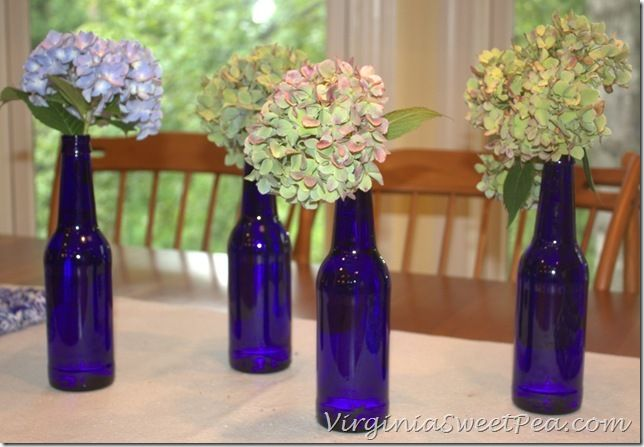 Beer Bottle Centerpiece from Sweet Pea (Who knew beer came in such pretty blue bottles?)