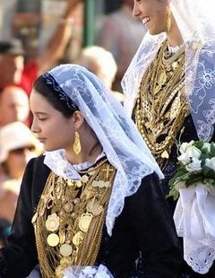 Portugal: Portuguese costume reveals a cultural and ethnic link to their Spanish relatives, with slight divergences to reflect Portugal's longer and distinct history. It is, interestingly, similar in many ways to Basque dress.