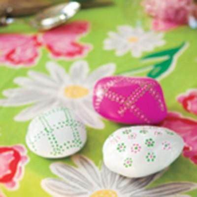 Decorate your table and weigh down a tablecloth with these adorable painted stones