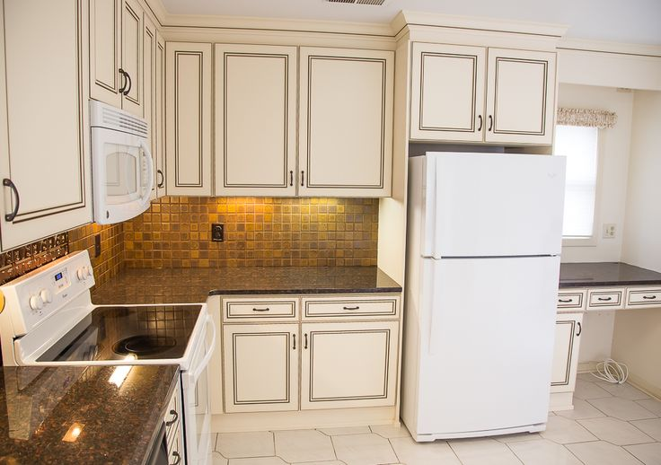 What a difference refacing can make! This kitchen was transformed with granite countertops and laminate cabinet doors. Helpful touches like undercabinet lighting, full extension drawers and a new cabinet add storage and usability. http://www.kitchensaver.com/kitchen/annapolis-md/