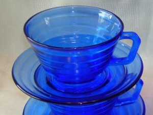 depression glass-Moderntone, by Hazel-Atlas Company, 1934-1942 Late 1940's-Early 1950's Cobalt Blue.  In the 1930's, a 36 piece set of cobalt Moderntone could be bought for $1.69 plus freight costs for 24 pounds as long as you sent two or four coupons from flour.    I have enough of this pattern to set a full table of 10.  Love it!