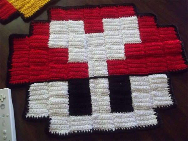 Esty crochet artist 'Harmonden' creates incredible 8 bit style rugs inspired by classic video games.