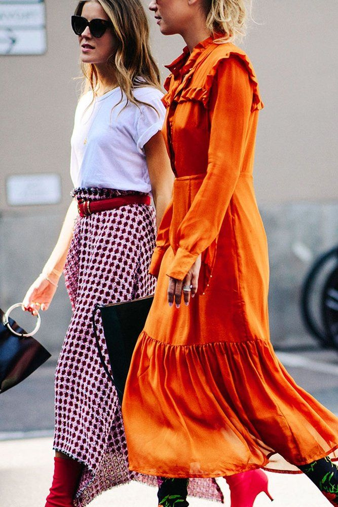 Street style orange maxi dress and red plaid skirt and red slouchy kitten heel boots