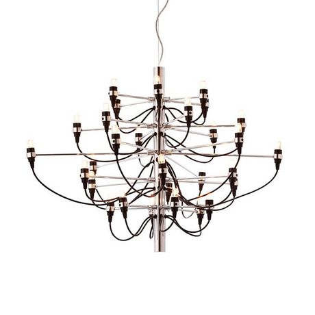 Cast a gentle, warm glow on an already romantic evening with the Chrome Contemporary Chandelier. Made of chrome and black phenolic resin, this striking light piece speaks a more contemporary language and updates the traditional design of the chandelier.