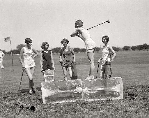 "July 9, 1926. ""Golf in bathing suits -- icing off at the tee. Miss Dorothy Kelly teeing off on a cake of ice. The others in the group are Misses Virginia Hunter, Elaine Griggs, Hazel Brown, and Mary Kaminsky of the Washington, D.C. area."""