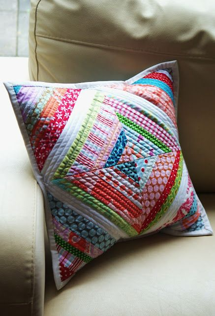 String Quilt Cushion.  Think it's time to pick out some fabrics and hit the thrift store. I need a pillow for my bed.