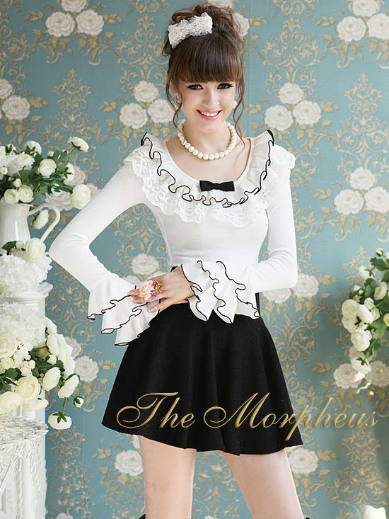Morpheus Boutique  - White Ruffle Long Sleeve Princess Shoulder Layer Trendy Shirt Top, $69.99 (http://www.morpheusboutique.com/products/copy-of-grey-ruffle-long-sleeve-princess-shoulder-trendy-shirt.html)