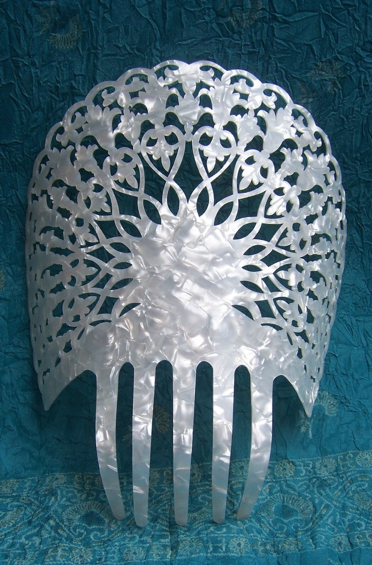 Vintage hair comb large faux mother of pearl Spanish dance mantilla hair accessory. $50.00, via Etsy.