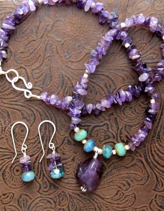 A beautiful deep purple amethyst gemstone nugget surrounded by silver spacers and turquoise colored handmade faceted glass beads catches the eye as the focal element of this amethyst chip necklace/earring set. Rich colors, wire-wrapping and handmade elements make this set a stunning accessory set for someone who appreciates gemstone jewelry. Due to the natural characteristics of the gemstones, each amethyst nugget and handmade glass bead necklace and earring set is one of a kind. The nec...