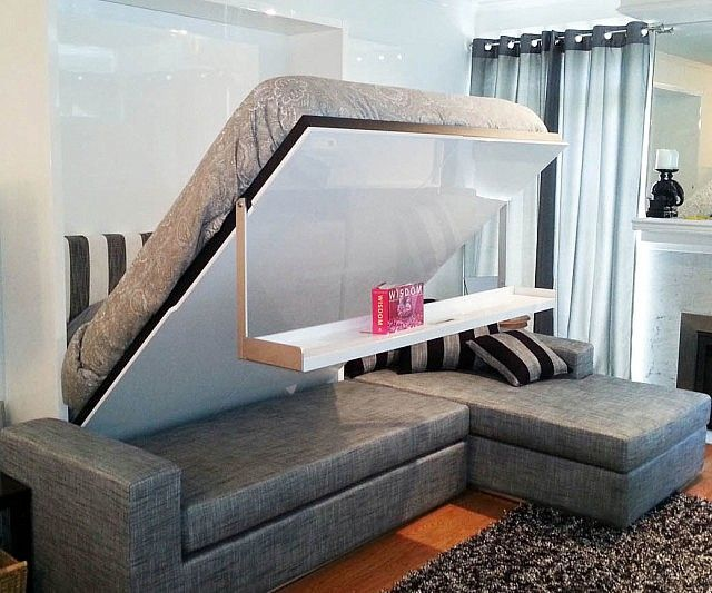 Maximize the space in your micro-loft without sacrificing style with the floating wall bed. Apart from providing a comfy place to sleep, the bed features a handy storage space on the bottom and lowers onto the floor without getting in the way of the couch underneath it.