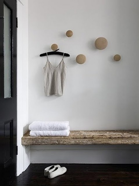 varied sizes of wooden knobs used as hooks such a great idea for a bathroom or even entrance area
