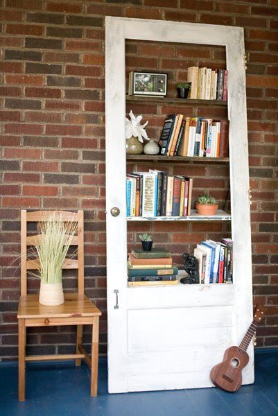 {Vintage Door Repurposed: Bookshelf} what a fab idea! could do same thing with old windows, perhaps?