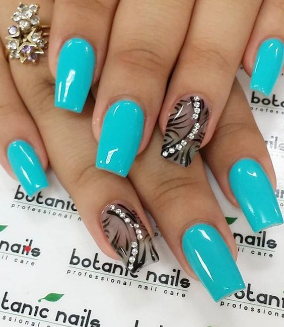 Neon blue and black winter nail art. There's nothing like contrasting colors combined to make the nail art stand out more. You can also add beads on top to make it look even more beautiful.