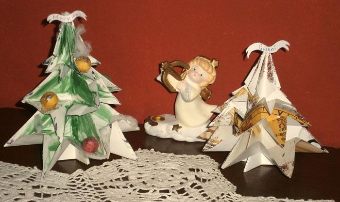 Segnaposto per la tavola delle feste realizzati con origami su carta riciclata.