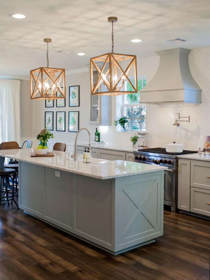 The new island has a marble top that extends out at one end, facilitating barstool seating and adding extra prep space.