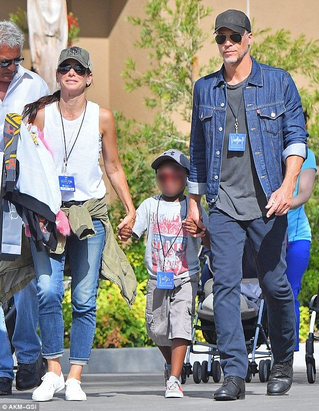 Family time: Sandra Bullock and her boyfriend Bryan Randall took her six-year-old adopted son Louis for a day out at Universal Studios in Hollywood last Friday
