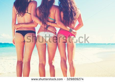 Friends at the Beach. Beautiful girls on sunny tropical beach in bikinis