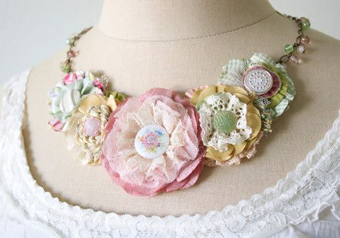 "Description This gorgeous floral statement necklace featuring layers of hand-cut and sewn fabrics in soft mint, ivory white and yellow hues will add ""WOW"" to any outfit, casual or fancy. Pretty textur"