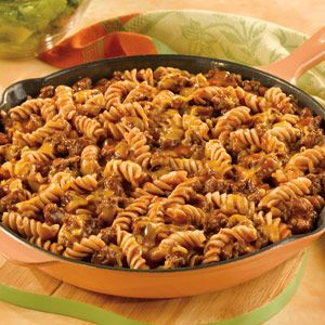 This dish features ground beef and onion simmering with tomato, pasta and cheese.