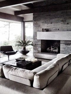 Stone Offcenter Fireplace With Long Mantel