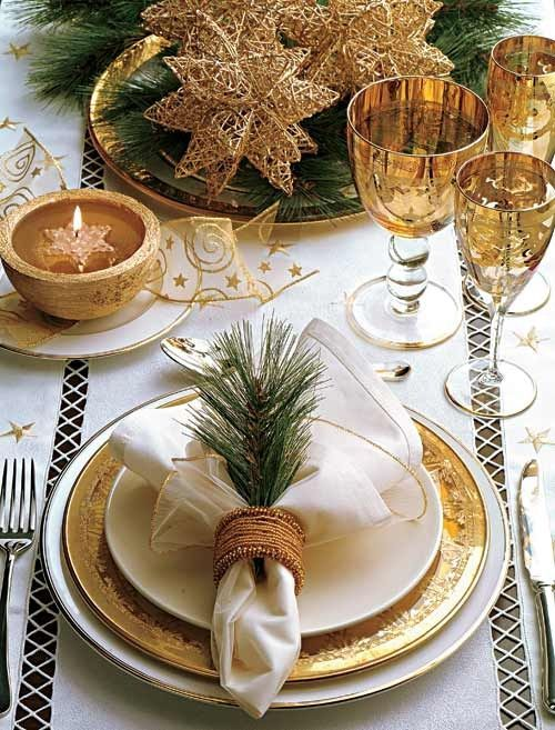 Golden Christmas for my dinning table: I have similar plates and glass set. I like the piece of pine in the napkin holder. An idea!