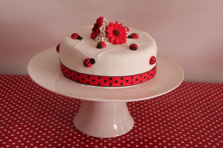 Lady beetle cake, made with chocolate mud cake, fondant and handmade fondant beetles