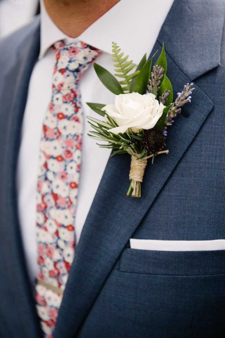 Boutonniere by Dark + Diamond Floral Design. Spray rose, fresh rosemary, lavender, ruscus and fern fronds wrapped in twine.