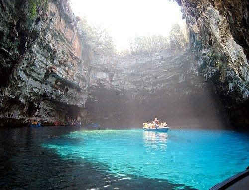 Kefalonia - Cave of Melissani. Kefalonia does not have the archaeological marvels of the other parts of Greece due to a massive earthquake in 1953, but it more than makes up for it with natural wonders such as this: Melissani Cave. With an entrance hidden by lush vegetation, you traverse a passage that opens out into this sky-blue semi-underground lake that seems bottomless as you gently boat across it, suspended between the real and the mythical worlds...