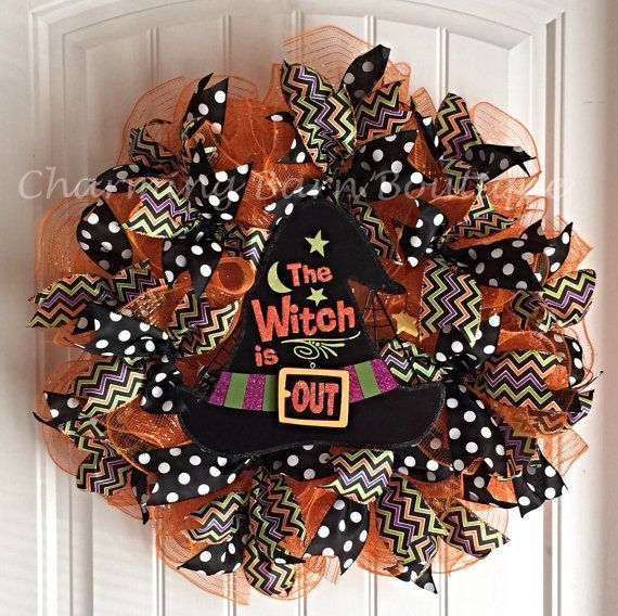 This Halloween mesh wreath lets your friends know if you are in or out. :) Cute witch hat sign that says The Witch Is In can also be