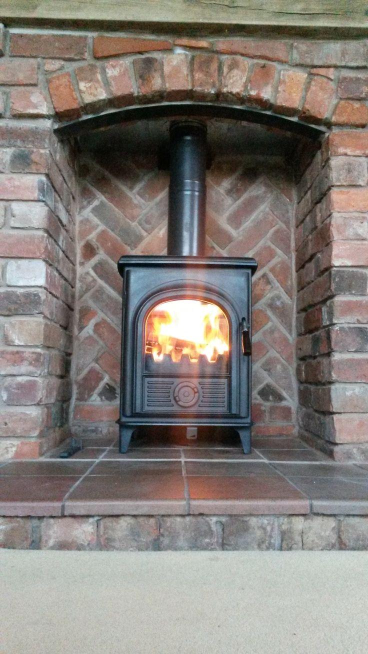 Alpha 1 Multi Fuel Stove and Brick Fireplace