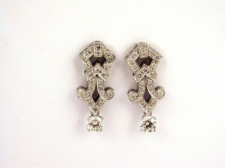 Earrings - Liberty. 18 carat gold (kt), white gold, 7.30 grams (gr).44 diamonds, brilliants cut 0.52 carat (ct)(G colour VVs clarity).2 diamonds, brilliants cut0.40 carat (ct) (G colour VVs clarity).Codex: ELOS.SS.