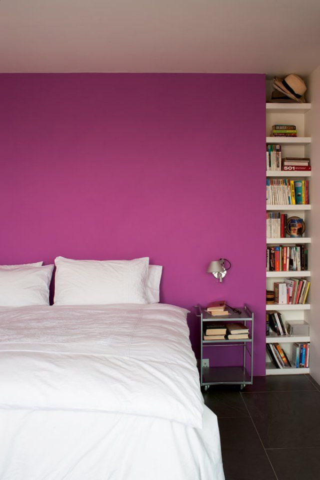 Bright pink bedroom in the London home of architects Patrick Theis and  Soraya Khan
