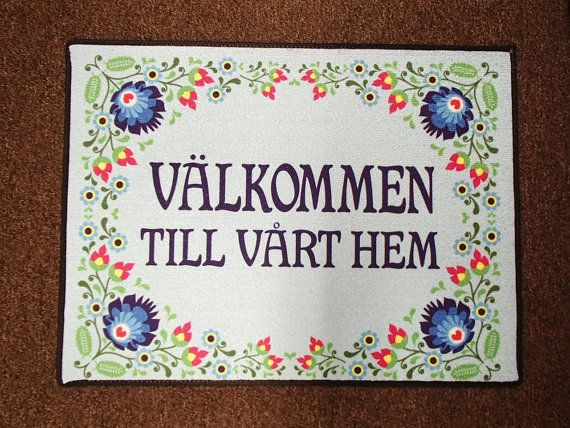 Swedish Door Mat with Welcome to our home in Swedish. The size is 18 x 24. The top is 20 oz loop rug. The design is printed with dye