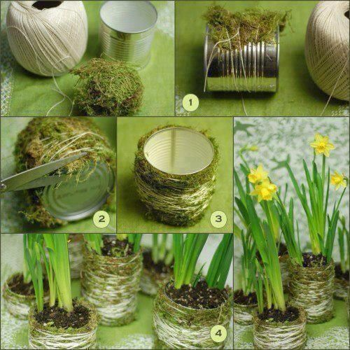 DIY moss covered cans, tied with twine.