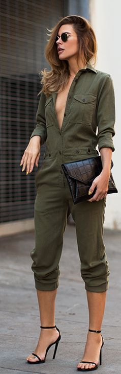 Unbuttoned utility overall loses its utilitarian vibe with the addition of strappy sandals and exotic-skin clutch.