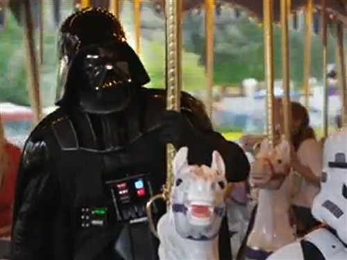 Darth Vader visits Disneyland, rides the teacups Ha Ha, guess this will be the 3 new Star Wars coming soon.