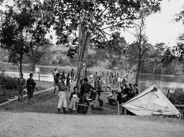 Union soldiers posing in front of and on a pontoon bridge across the James River at Deep Bottom, Virginia, during the Siege of Petersburg. Attributed to Mathew Brady.