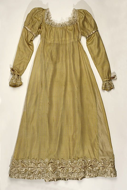 Afternoon Dress of Goldenrod Patterned Silk, with Bronze Passementerie Trim on Hemline. French, c. 1814.