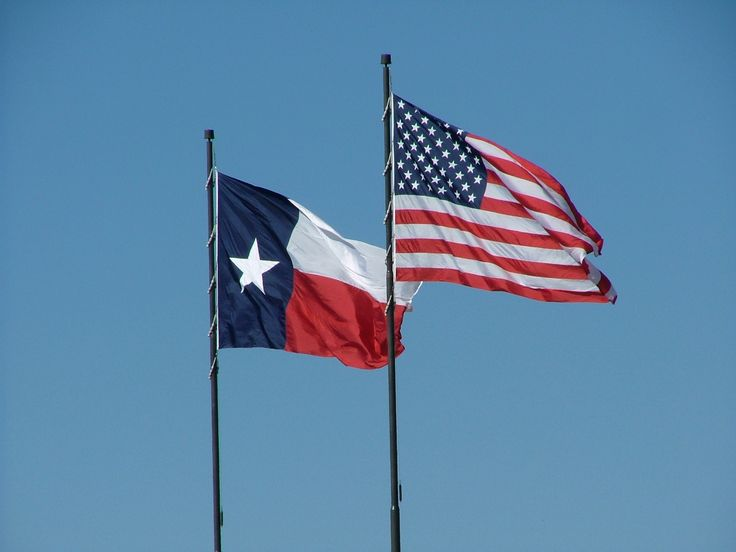 texas flag pictures | US and Texas flags against a Texas blue sky.