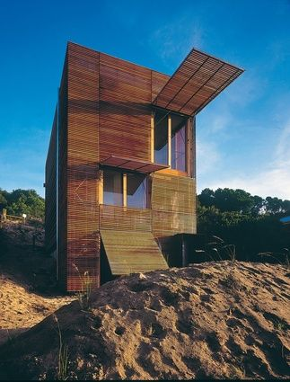 Carter/Tucker House (1998–2000): tilt-up panels in the timber-battened facade open like awnings to create a verandah-like room in the interior.