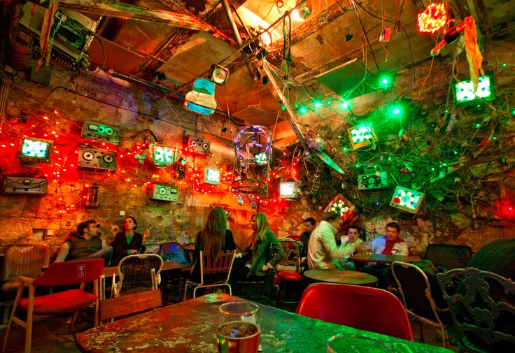 This bizarre cafe is called Szimpla and it's in Budapest.  During the day, it's a popular hang out spot and an art gallery- displaying some crazy artifacts and weird things.  At night, it becomes one of the most unique and awesome bars in the world (no joke)! I went here everyday when I was in Budapest.  It's massive inside (over a dozen rooms), with really cool people and amazing positive vibes!