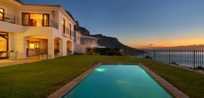Toast the sunset from your luxurious perch at Abaco Villa | Camps Bay