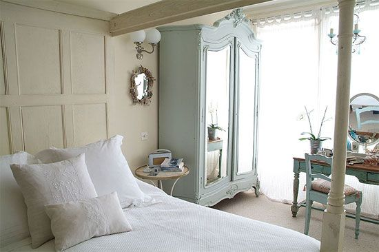 I love the pale blue armoire in this bedroom, it is so me......
