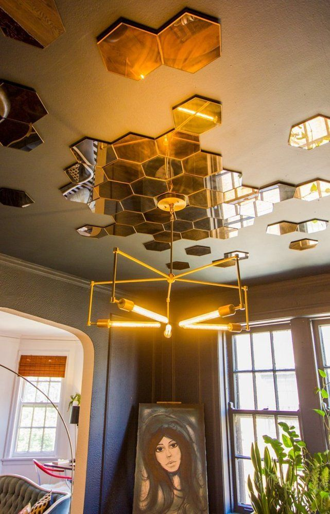 Scattered hexagon mirrors on the ceiling are a good alternative to a ceiling medallion.