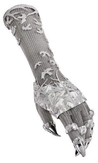 The Glove :: A diamond set armour-inspired piece    Striking diamond birds cascade around the arm, as though caught in mid-flight.