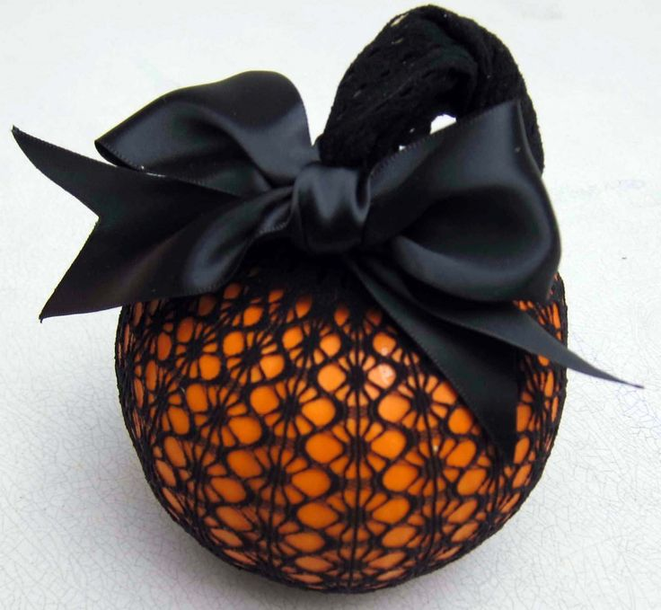 Dollar Store Black Patterned Pantyhose & Michael's Satin Ribbon = Elegant Pumpkin!