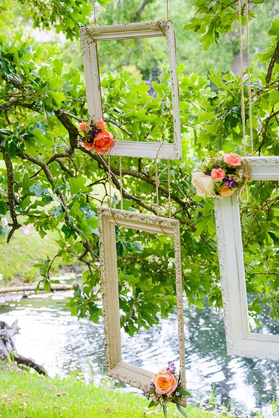 frames hanging from trees // http://www.deerpearlflowers.com/vintage-frames-wedding-decor-ideas/