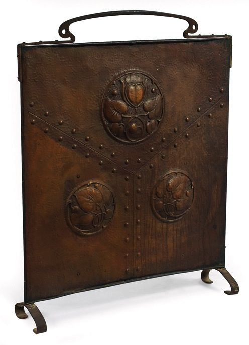 "Arts and Crafts fire screen, organic design in copper repousse with decorative rivets on an iron stand, 29.5""w x 7.5""d x 37""h www.treadwaygallery.com"