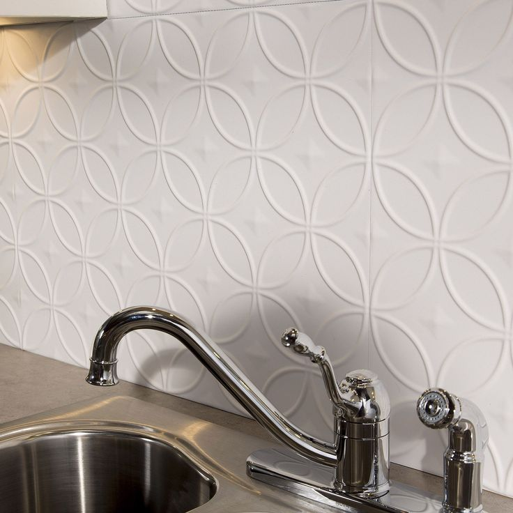 This 18 sq. ft. kit includes Six (6) backsplash panels, Four (4) 4-foot j-trim pieces, Two (2) 18-inch inside corner pieces and Four (4) rolls of double sided tile decorative wall tile adhesive tape.