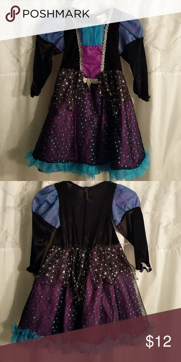 """Witches or wizard dress. Super cute Witches dress. Velvet bodice, silver detail stitchery, purple dress with sheer black over lay w/ teal sparkle oval like shapes. 2nd over lay of skirt short black chiffon, zig zag w/ stars. Teal chiffon ruffle at bottom. Silver bow at waist and at bottom of each sleeve. Shoulders slight puffy effect. Size reads small will fit size 4/5. Minor defect: in back of dress slight 1/2"""" detachment/gap of the top star layer. Can be worn w/o seeing or it is an easy…"""
